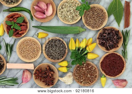 Herb and spice selection over marble background.