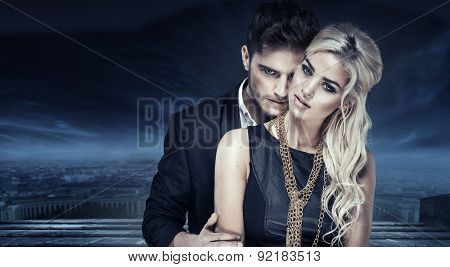 Elegant fashion couple over city background