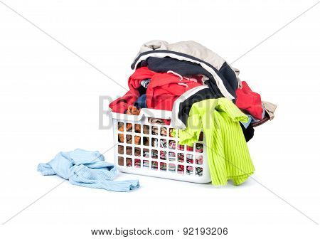 Bright Clothes In A Laundry Basket On White Background