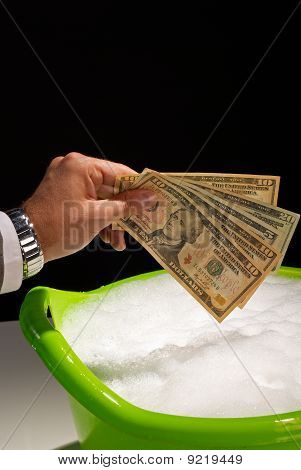 Putting money to soak money laundering concept poster