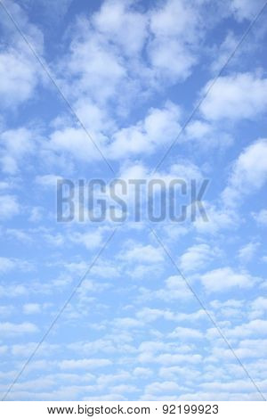 Bright sky with clouds - vertical background