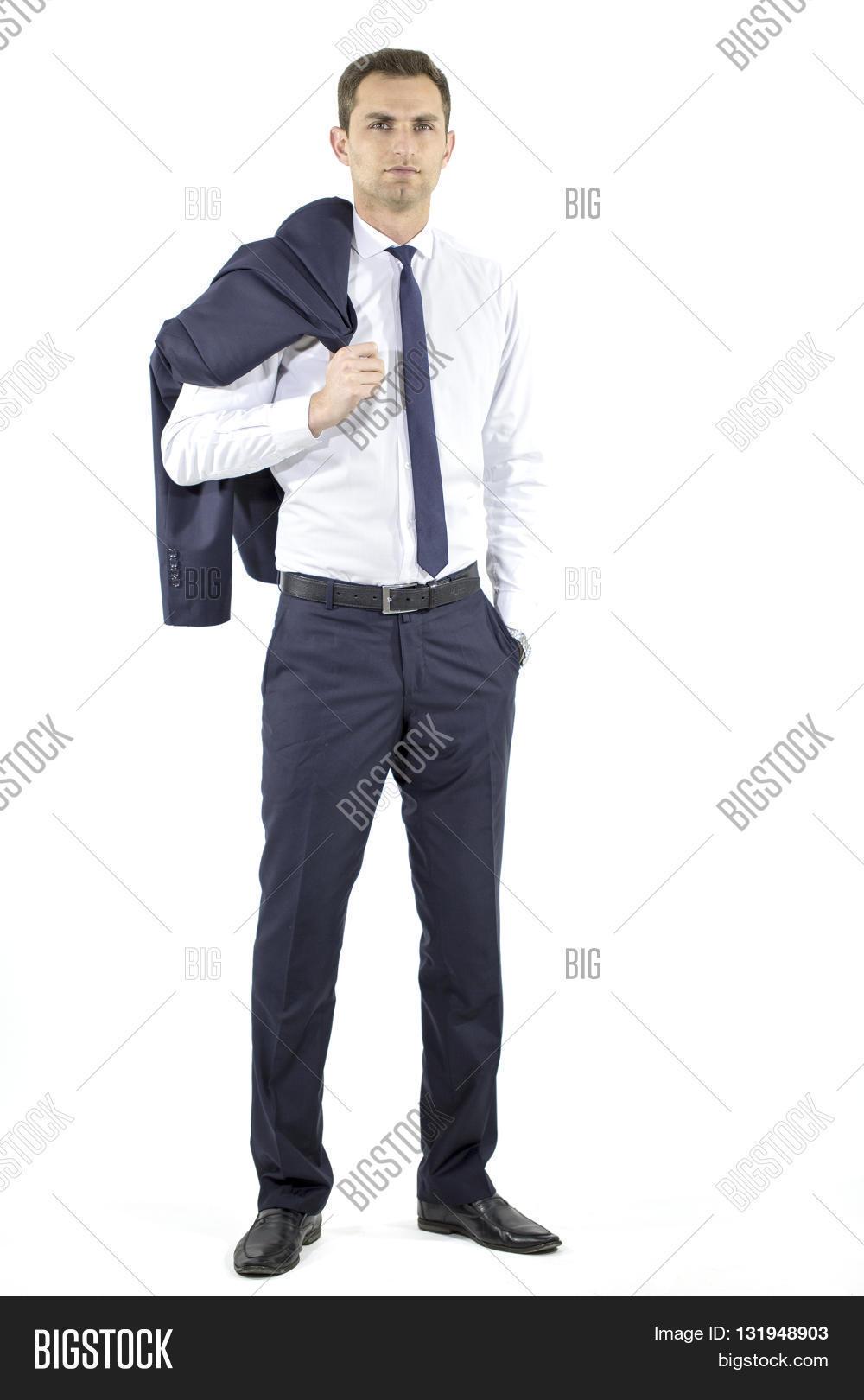 3503152c23 handsome Hispanic elegant man in black suit on grey background, holding the  coat over his