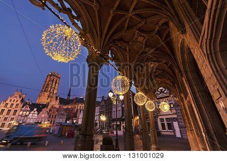 Grote Markt and arches of city hall in Mechelen at sunrise. Mechelen Flemish Region Belgium