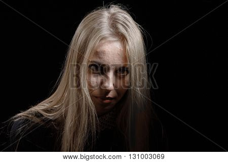 pimply skin blond girl on black background