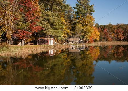 Autumn trees reflected in a forest lake Marinette county Wisconsin