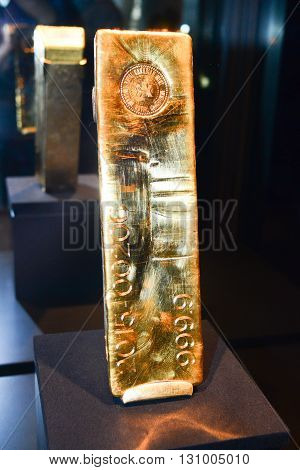 Hull Canada - May 21 2016: A gold bar of 400 ounces (12.4 kg) from Royal Canadian Mint at Canadian museum of history exposition.
