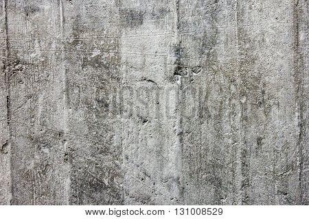 Rough surface grey monolithic concrete as a texture close-up
