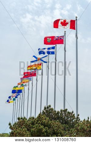 Picture of the canadian Flag along with the flags of the 10 Canadian Provinces and the 3 Canadian Territories in Ottawa Canada