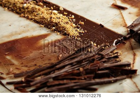 Close Up Melted Homemade Chocolate Crunches With Nuts On Stone Marble Table In Bakery, Professional