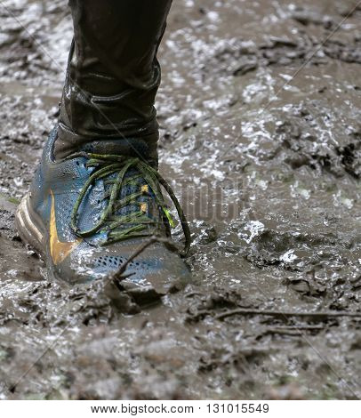 STOCKHOLM SWEDEN - MAY 14 2016: Shoe in the mud in the obstacle race Tough Viking Event in Sweden April 14 2016