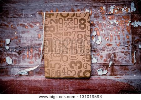 Notebook On The Background Of Old Shabby Doors, Vintage