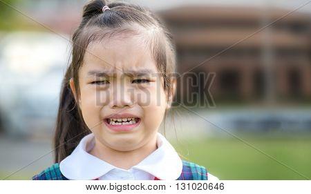 Image Crying child in the school uniformhaving