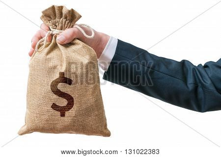Hand Of Businessman Holds Bag Full Of Money. Isolated On White B