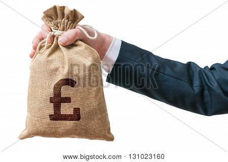 Hand Of Business Man Holds Bag Full Of Money With British Pound