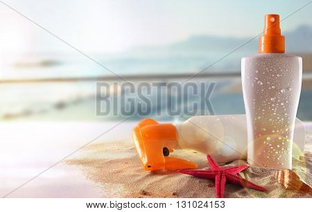 Two Sunscreen On Table In Terrace Overlooking Beach