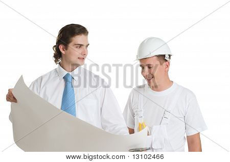 Engineer And Worker Discussing Blueprints