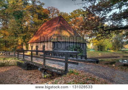 Old dutch watermill in vintage HDR colors