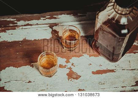 Two Glasses Of Whiskey Standing On The Bar