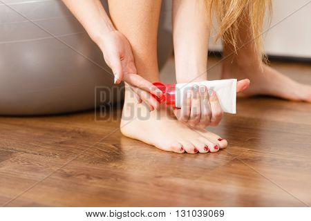 Woman Fit Girl Putting Ointment On Bad Ankle
