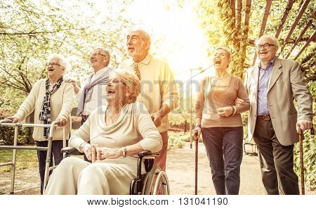 Group of old people walking outdoor. happy group of old friends