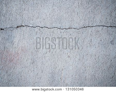 Texture and pattern of cracked cement wall.