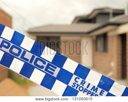 Melbourne, Australia -May 19, 2016: Blue and white Police tape cordoning off a building site like a crime scene
