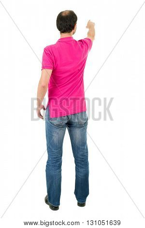 young casual man full body, pointing, in a white background