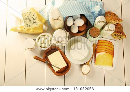 Set of fresh dairy products on white wooden table