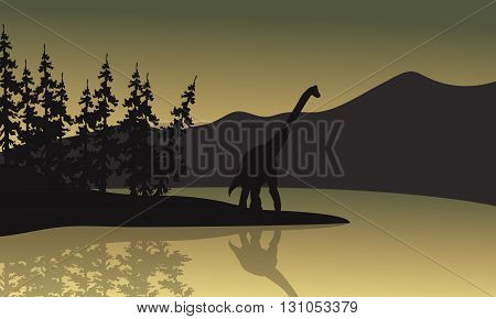 Silhouette of brachiosaurus in riverbank a beautiful scenery