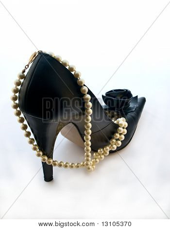 One Black Shoe With Pearl Beads