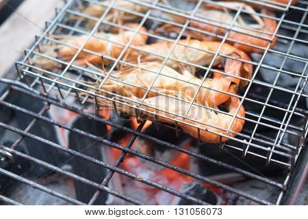 Grilled fresh  shrimps on grill. Close up