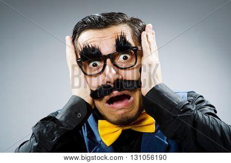 Funny man against dark background
