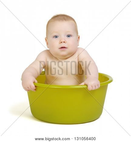 Cute baby having bath in the tub