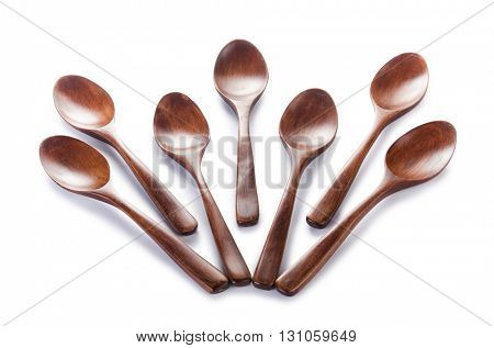 Many wooden spoons isolated on white