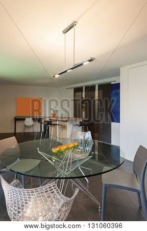Glass table with chairs, Interior of a studio apartment