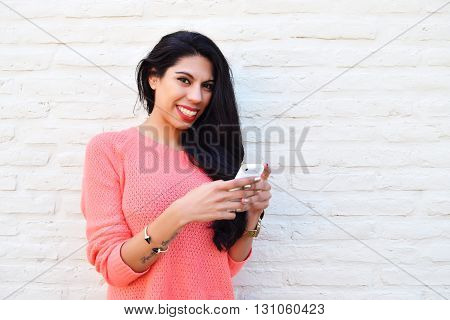 Young Latin Woman Using Her Cellphone