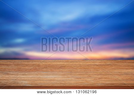 Top of wooden table on blue sunset sky background, stock photo
