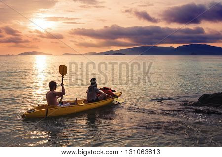 Couple kayaking in sunset, holiday vacation summer times, dating, romantic, romantic, vintage tone