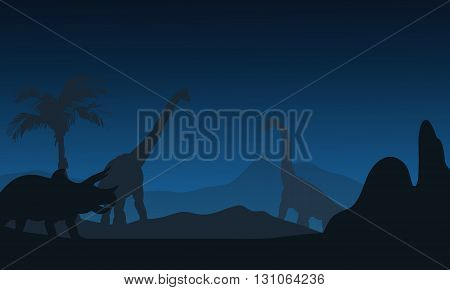 At night silhouette of Triceratops and brachiosaurus with blue backgrounds