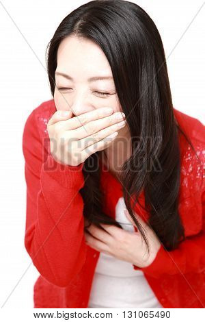 portrait of Japanese woman feels like vomiting on white background