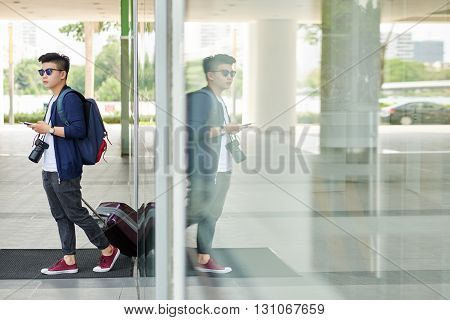 Professional Asian photographer arriving to new city