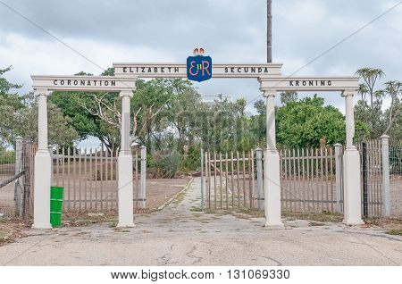 UITENHAGE SOUTH AFRICA - MARCH 7 2016: The Queen Elizabeth II coronation gates with the King George V memorial at the top of Canonhill