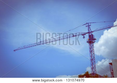 Large Construction Crane Machine With Clear Blue Sky Background
