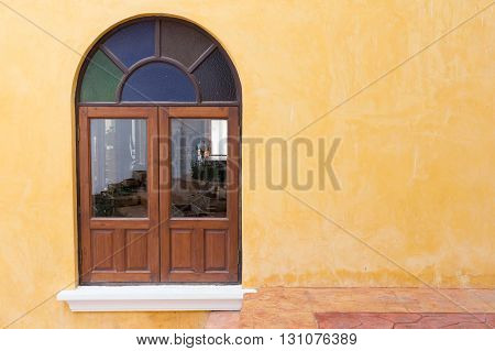 Wood Window On Yellow Cement Mortar Wall Background
