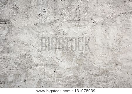 Old white concrete wall with plaster grungy background.