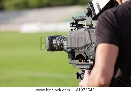 Tv camera broadcasting during a football (soccer) match