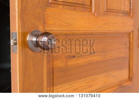 Door Knob And Keyhole On Wooden Door