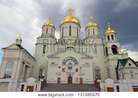 the Church of St. Nicholas the Wonderworker (the city of Nizhny Novgorod Avtozavodskiy district Russia) and cumulonimbus clouds