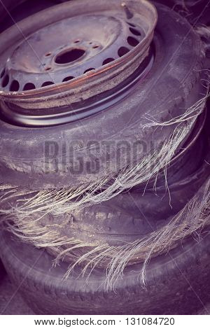 Close up shot of a pile of blown out tires.