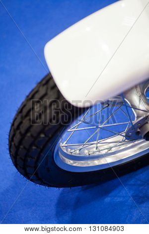 Close up shot of a motorcycle wheel with fender.